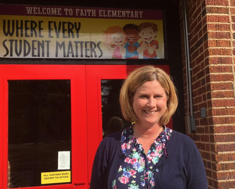 Principal Denita Dowell-Reavis stands in front of the doors to Faith Elementary, a school in Rowan County.