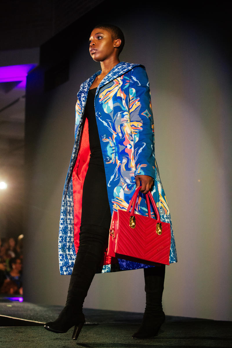 A model poses on a runway during a fashion show for the kickoff of the exhibit, Inspiring Beauty: 50 Years of Ebony Fashion, at the North Carolina Museum of Art in Raleigh, N.C. on Saturday, Oct. 28, 2017.