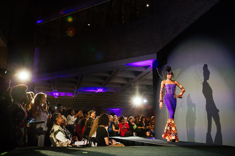 Model Anita Taylor walks down a runway wearing a desgign by Desiree Hedrick during a fashion show for the kickoff of the exhibit, Inspiring Beauty: 50 Years of Ebony Fashion, at the North Carolina Museum of Art in Raleigh, N.C.