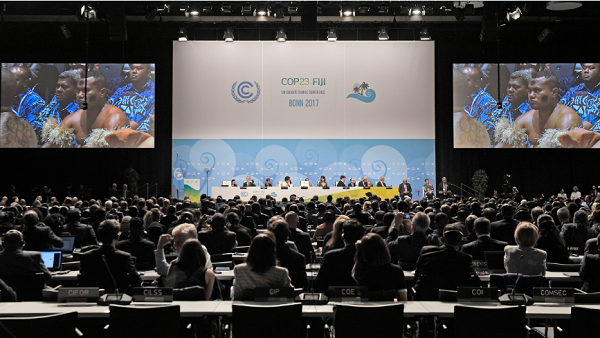 In this Monday, Nov. 6, 2017 file photo, Native people from Fiji sit in the convention center during the opening of the COP 23 Fiji UN Climate Change Conference in Bonn, Germany.