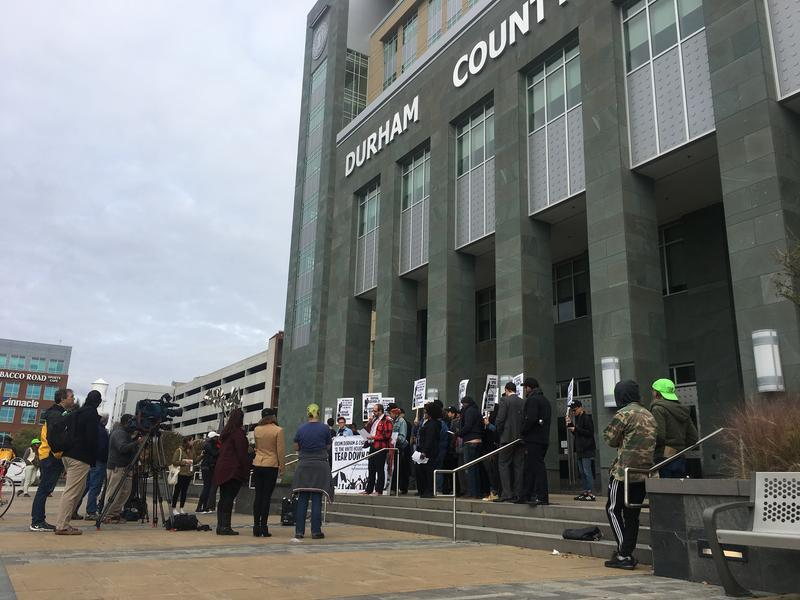 Protesters with the #DefendDurham movement outside the Durham County Courthouse
