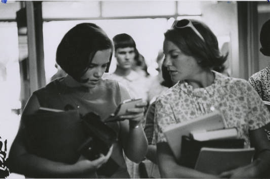 Students walking through hallway, 1967