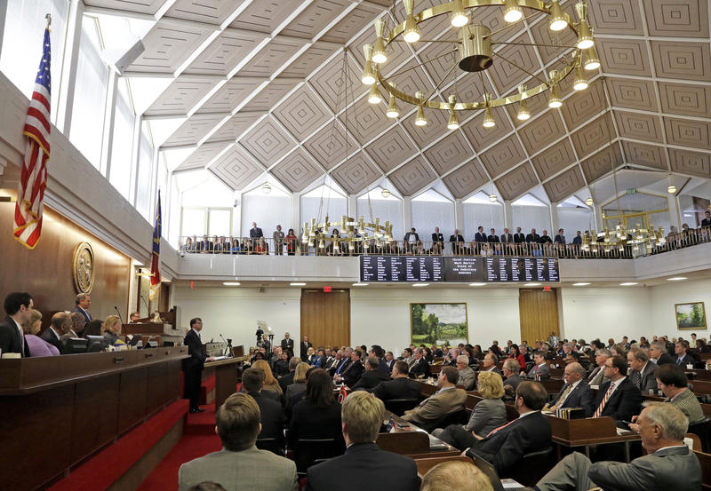 FILE- In this March 4, 2015, file photo, North Carolina Chief Justice Mark Martin delivers his State of the Judiciary address to a joint session of the General Assembly.