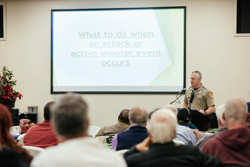 Guilford County Deputy Dan Harris speaks during a seminar on active shooter safety at Calvary Baptist Church in McCleansville, N.C. on December 5, 2017.