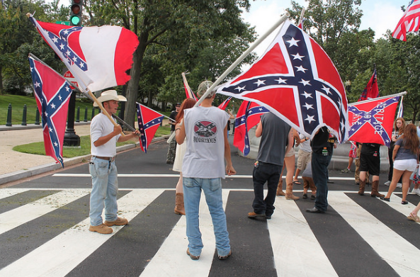 people marching with confederate flags in Washington, D.C.
