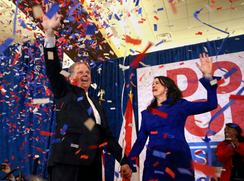 Democratic candidate for U.S. Senate Doug Jones and his wife Louise wave to supporters before speaking Tuesday, Dec. 12, 2017, in Birmingham, Ala.