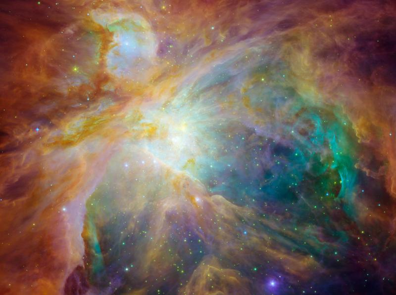 colorful clouds of gas and dust in the orion star-forming region