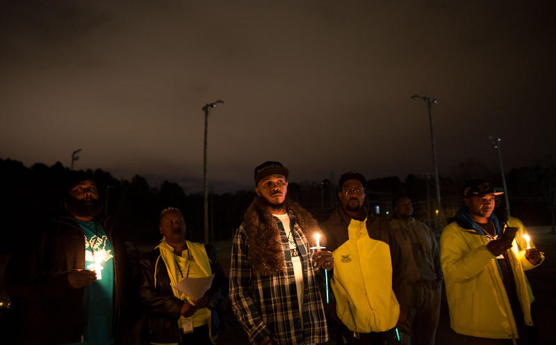 "Supporters and members of Bull City United lead a ""Week of Peace"" candlelight vigil at the Cornwallis housing community on Wednesday, January 10, 2018."