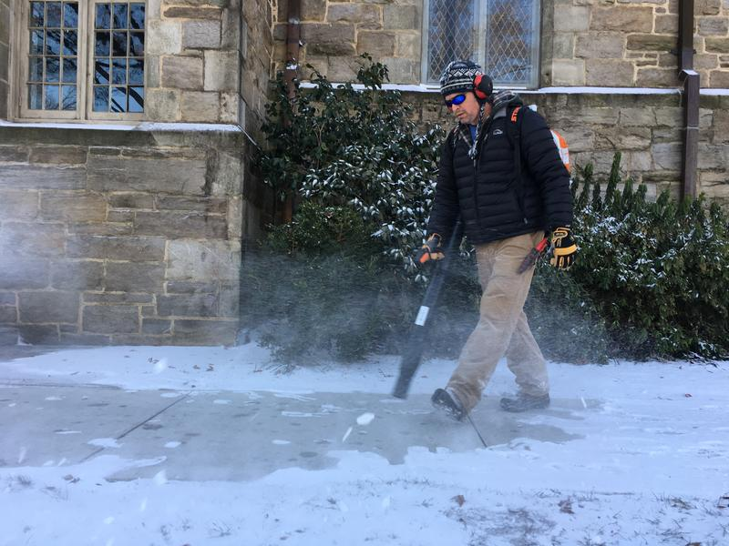 Tom Knott blew snow off the steps and sidewalks around Christ Church in downtown Raleigh. Knott works on the church's maintenance crew.