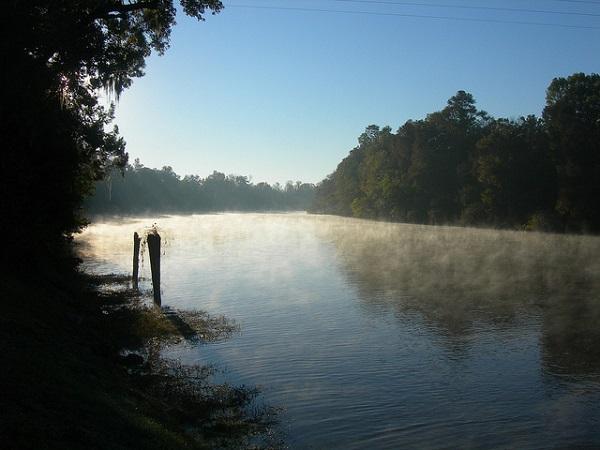 mist rises off the Cape Fear River