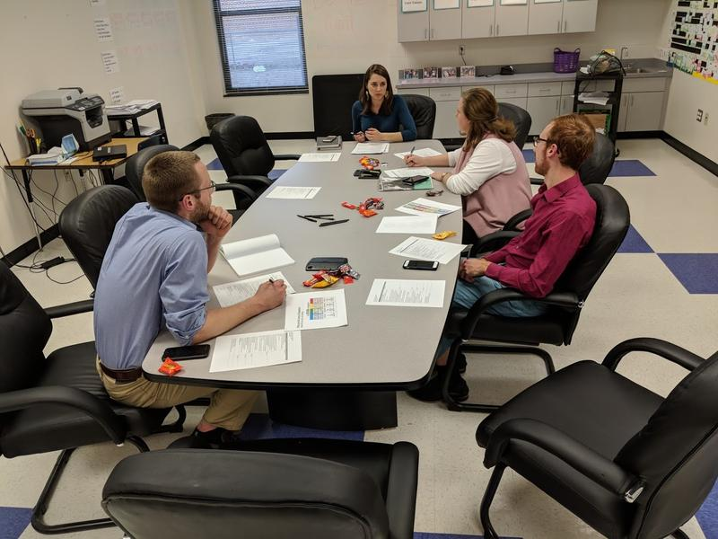 Elizabeth DeKonty, a fellow with the Public School Forum of North Carolina, speaks with Pattillo Middle School's resilience team about strategies for supporting students, many of whom live in poverty.