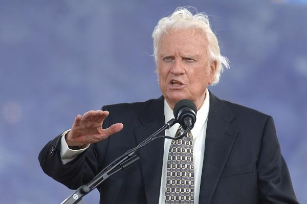 photo of Billy Graham speaking a microphone