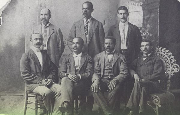 Black and white photo of seven african american men