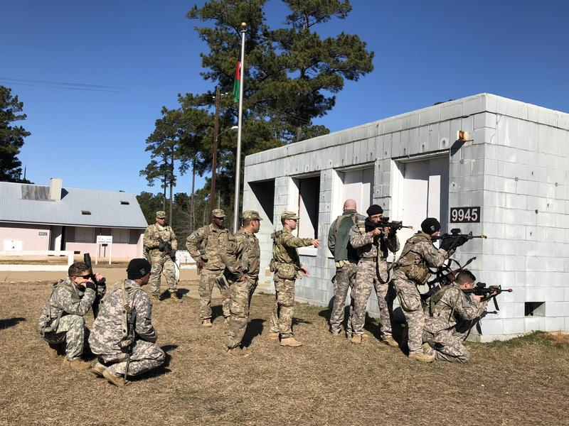 "U.S. advisors practice training ""Afghan soldiers"" — actually American troops  brought to Fort Polk to augment civilian role players actually from Afghanistan. Looking on are trainers who are evaluating the advisors' performance"