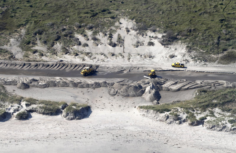 File photo of sand being removed from highway N.C. 12 on Ocracoke Insland, N.C., Sunday, Aug. 28, 2011 after Hurricane Irene.