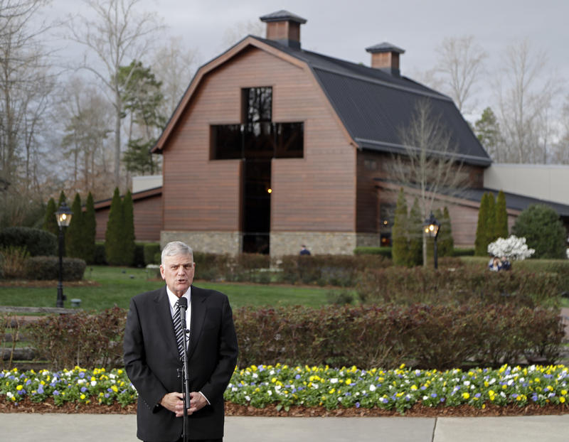 Franklin Graham speaks to the media in front of the Billy Graham Library after greeting former President George W. Bush and wife Laura Bush, who came to pay their respects to Billy Graham during a public viewing in Charlotte, N.C., Monday, Feb. 26, 2018.