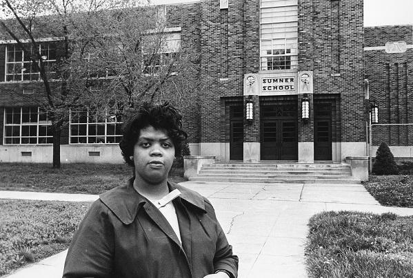 photo of Linda Brown Smith in front of a school