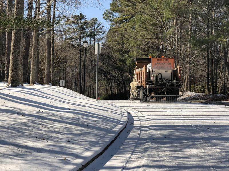 File photo of a Chapel Hill municipal truck spraying ant-icing on the streets in anticipation of an expected January 2018 hard freeze. Forecasters are calling for more winter weather across the state this evening.