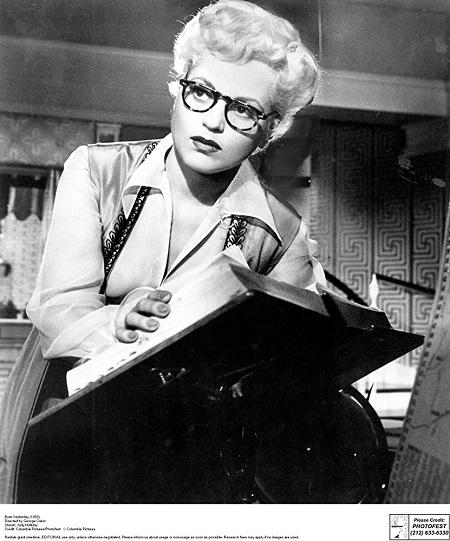photo of judy holliday leafing through a book
