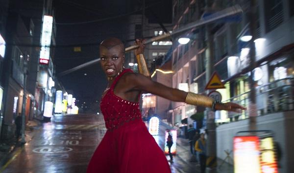 photo of Danai Gurira on top of a car holding a weapon