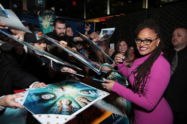 photo of ava duvernay signing posters for fans