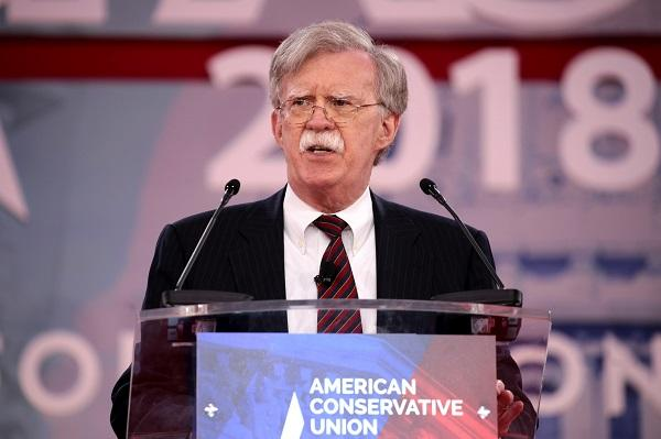photo of john bolton speaking at a podium