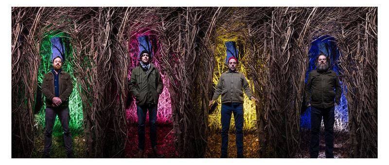 photo of four men in the woodsy sculpture from duke gardens