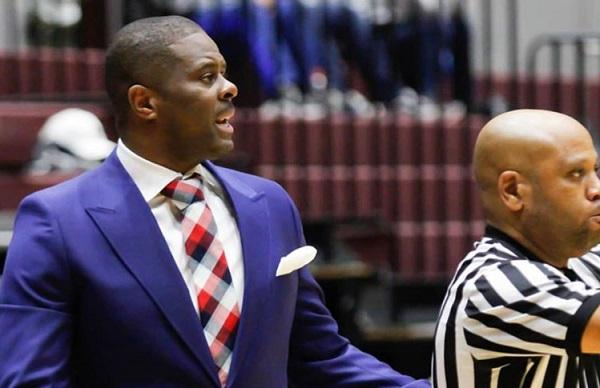 photo of Levelle Moton and a referee in action