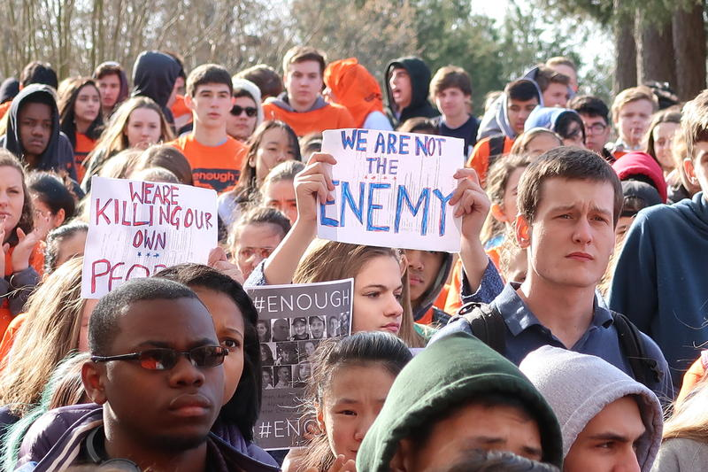 Students at East Chapel Hill High walk out of their class on Wednesday, March 14, 2018 as part of a nationwide call for tighter gun control measures.