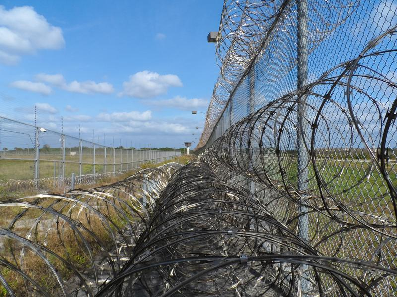 A barbed wire fence stock image
