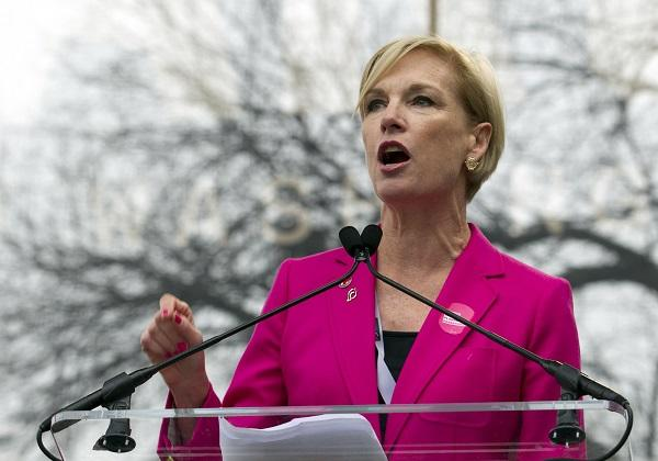 photo of cecile richards speaking at a podium at the women's march