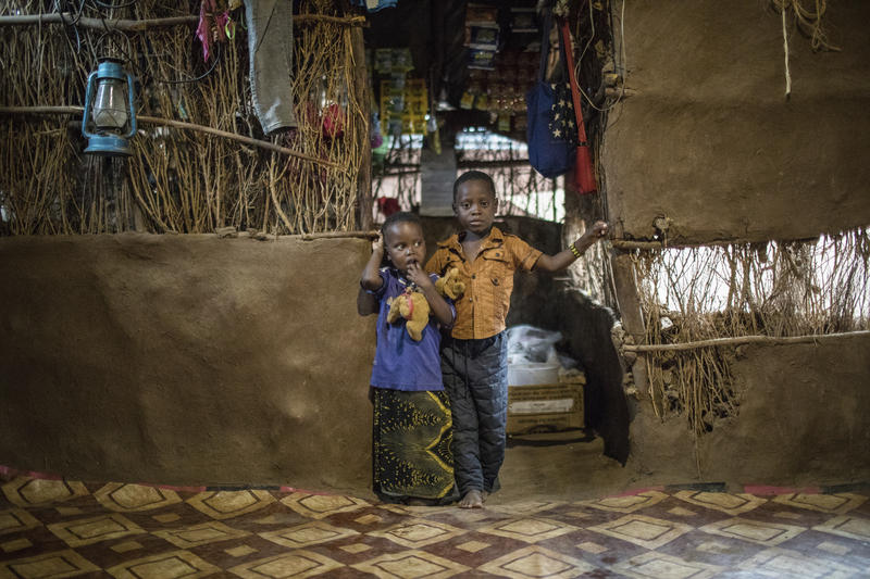 In this April 16, 2018 photo, three-year-old Shukri Muhamed, left, and her brother Ibrahim, 6, stand in their home at the Kakuma Refugee Camp in Kakuma, Kenya, where they live with their mother Saido Muhina Khamis. Khamis thought she'd be in the United St