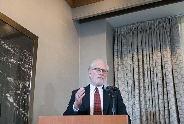photo of David Crane speaking at a podium