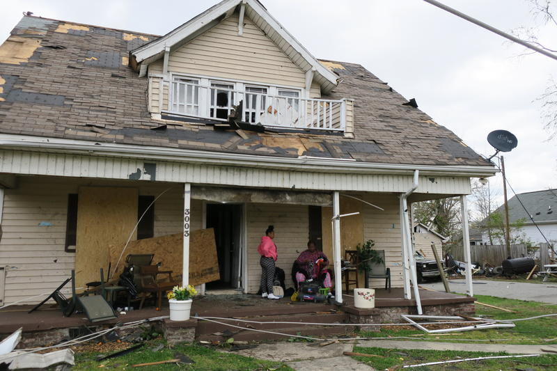 Mary Carelock sits on the porch of her home on East Bessemer Avenue with her daughter. She was enjoying the rain on her porch Sunday evening when the tornado struck. Her house was destroyed.