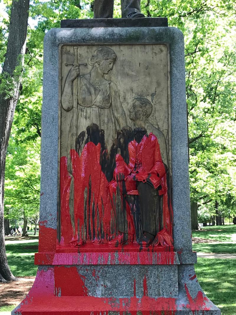 The base of the Confederate monument at UNC-Chapel Hill known as Silent Sam was doused in red Monday, April 30, 2018