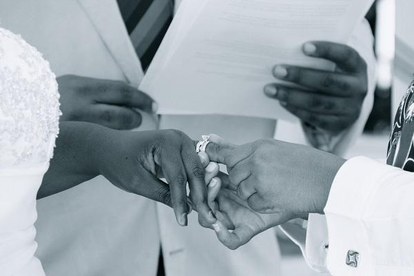 close up photo of people exchanging rings during a wedding ceremony