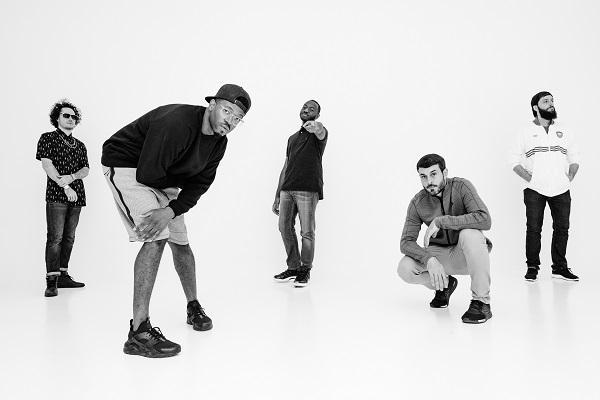 members of kooley high posing against a black backdrop