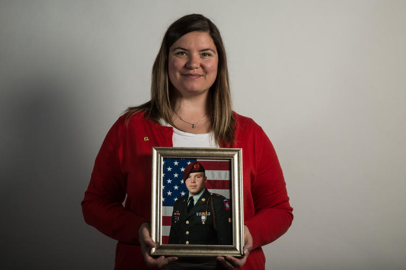 Laura Monk holds a portrait of her husband Austin, who passed away in 2011 after battling leukemia.