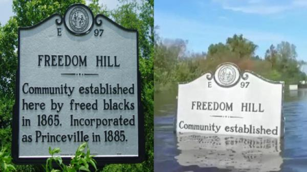 text of the sign: 'Freedom Hill: Community established here by freed blacks in 1865. Incorporated as Princeville in 1885.'