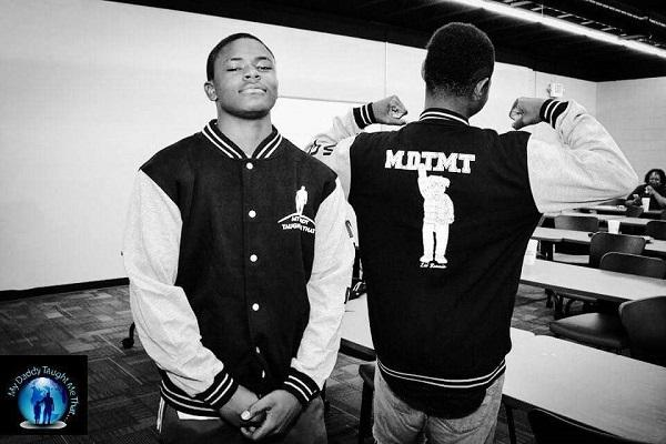 photo of a young man wearing a varsity jacket with the letters 'mdtmt' on the back