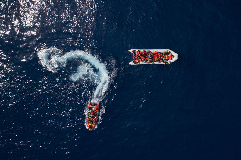 refugees and migrants in boat