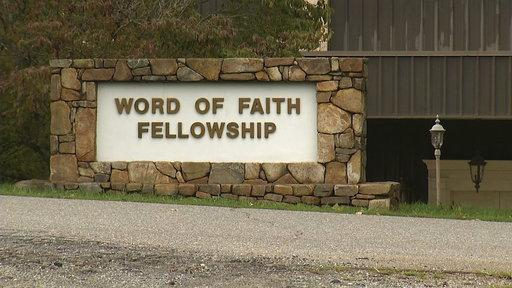 This 2016 image from video shows the entrance to the Word of Faith Fellowship church in Spindale. A father and son who belong to the secretive evangelical church in North Carolina pleaded guilty Friday, May 25, 2018, to federal criminal charges.