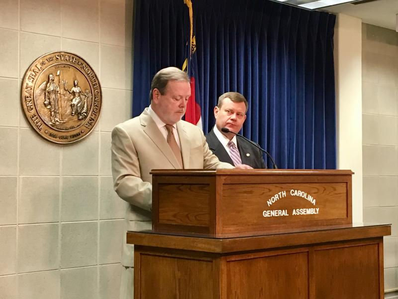 Phil Berger and Time Moore stand at a podium inside the North Carolina General Assembly.