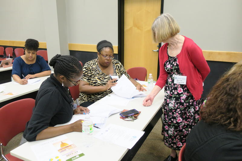 Winston-Salem AAUW board member, Janice Imgrund, helps participants Natasha Evans (left) and Lashuanda Lash (right) during one of their salary negotiation exercises. The workshop is one of several taking place across the country.