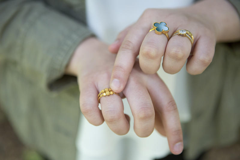 Sarah Alsammak shows off her rings, each of which has a special meaning to her