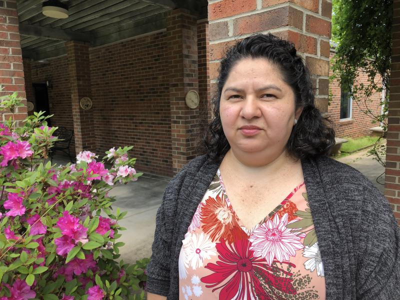 Juana Luz Tobar Ortega stands outside St. Barnabas' Episcopal Church in Greensboro, where she is living in sanctuary.