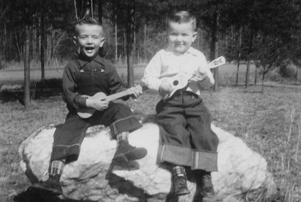 photo of two toddlers holding instruments