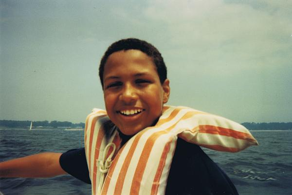 photo of cox as a child in a life jacket, before transitioning.