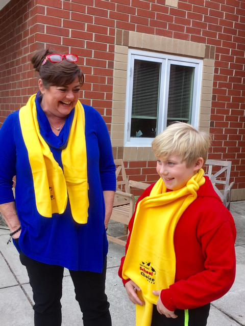 Kara White, left, and her son Chandler White sport yellow scarves to celebrate National School Choice Week.
