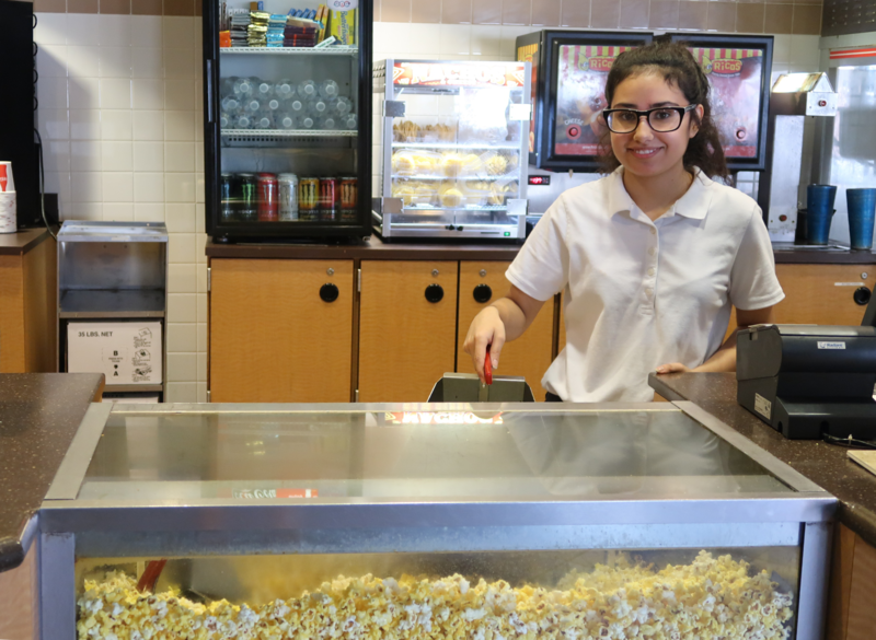Northgate Stadium 10 employee Maria Parra serves refreshments to students at the occasional sensory-friendly screenings.